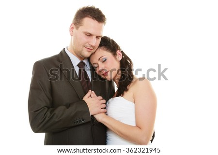 Wedding day. Love and affection. Portrait of hugging bride woman girl in white dress and groom man in elegant suit. Married couple isolated on white.  - stock photo