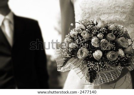 wedding day(special sepia toned film photo f/x,focus point on the flowers) - stock photo