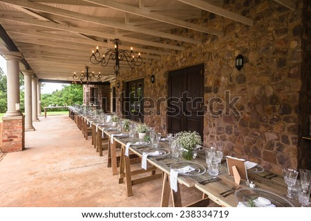 Wedding Decor Home Wedding decor chairs ceremony lawn pool landscape with guests lunch dinner table settings on porch veranda of mansion home. - stock photo
