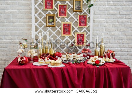 Wedding decor red table sweets stands stock photo edit now wedding decor red table with sweets stands behind a white brick wall junglespirit Image collections