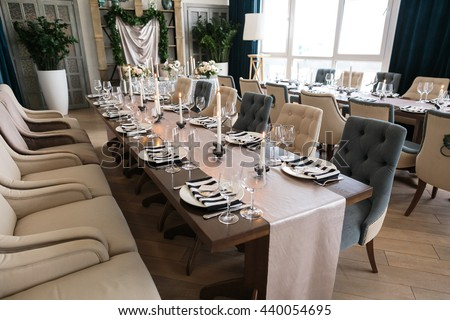 Wedding decor. Wedding interior. Festive decor. Table decor. Festive Table layout. Pastel tone. Restaurant interior. The burning candles on a table.