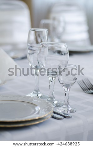 Wedding decorated table. Luxury light decor on table in restaurant - stock photo