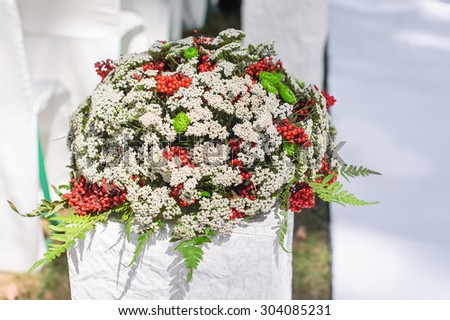 wedding decoration bouquet of flowers to decorate the ceremony - stock photo