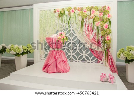 Wedding decoration. Flowers,bouquet in front of wedding background. Table set for wedding or another catered event dinner. - stock photo
