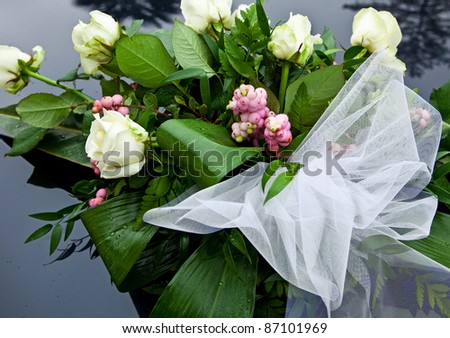 Wedding decoration - flowers on the hood of the car - stock photo