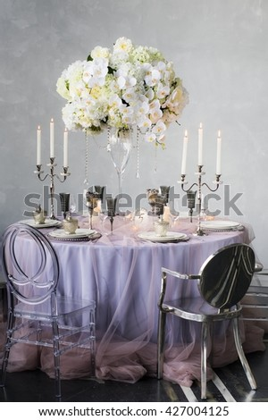 Wedding decoration for banquet with orchids and candles