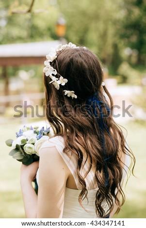 Wedding decoration. Fresh delicate magical wedding wreath white flowers on beautiful bride close-up. - stock photo