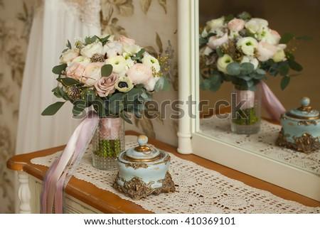 Wedding decoration. Vintage background, accessories. Wedding bouquet. Morning bride. Wedding rings. - stock photo