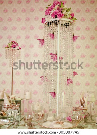 Wedding decorations table with crystal and flowers  - stock photo