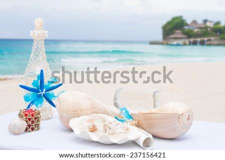 wedding decorations, wedding table for beach outdoor wedding ceremony in tropics - stock photo