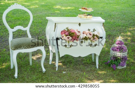 Wedding decorations with flowers , candles and furniture