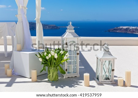 Wedding decorations with white tulips on the background of the sea