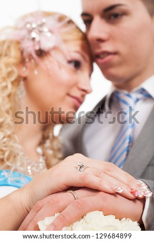 Wedding detail of bride and groom. Shallow depth of field with focus on hands. - stock photo