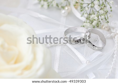 Wedding detail with beautiful golden rings - stock photo