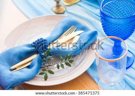 Wedding dinner table detail in white, gold and blue color. Selective focus. DOF - stock photo