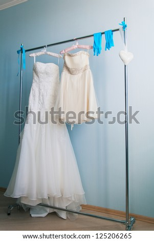 wedding dress and accessories on hanger - stock photo