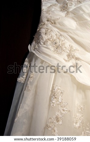 Wedding Dress close up on a black background - stock photo
