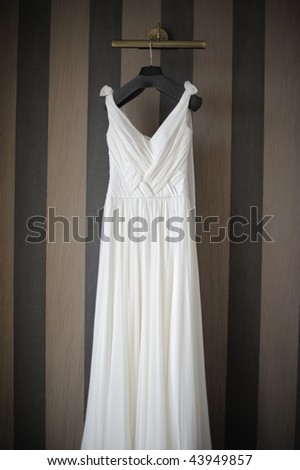 Wedding dress hanging on a shoulder