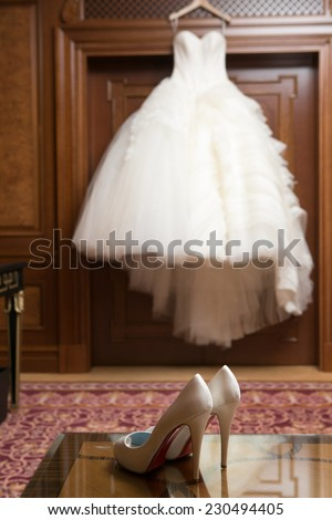 Wedding Dress Hanging Up By The Window