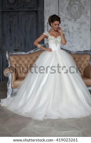 Wedding dress in Paris. Bride in a luxury apartment in a wedding dress. Bride in wedding dress in his apartment in Paris.  The girl in a wedding dress in luxurious suites - stock photo