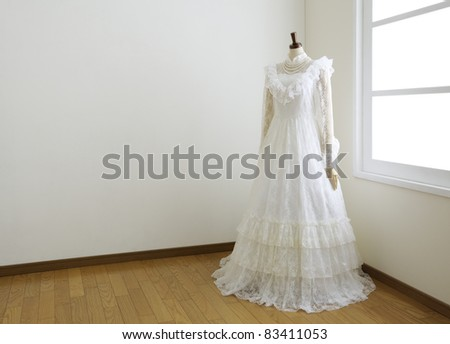 Wedding dress in white room.