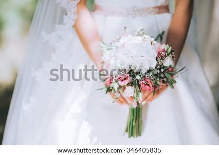 wedding dress, wedding rings, wedding bouquet - stock photo
