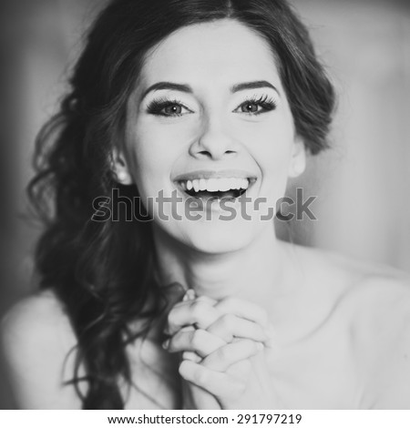 Wedding emotions of young happy bride. - stock photo