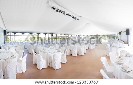 Wedding, event, celebration,  banquet, dinner, reception area tent - stock photo