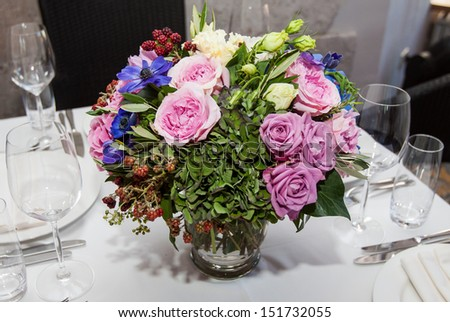 wedding exclusive bouquet on banquet table