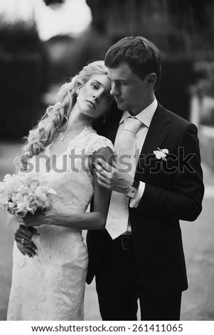 Wedding fashion portrait of young couple with nice boquet