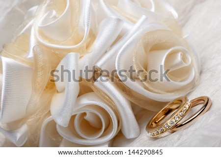 wedding favors and a gold wedding ring - stock photo