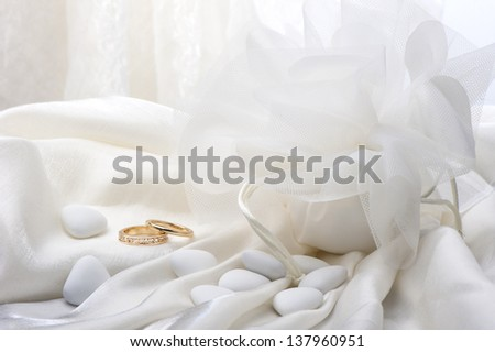 wedding favors and wedding ring on white background - stock photo
