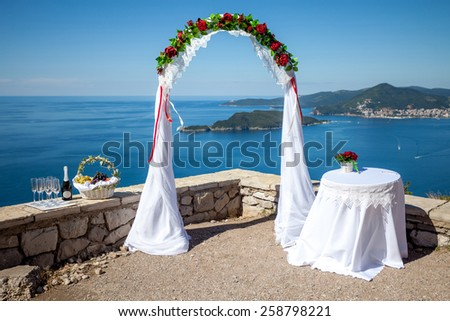 Wedding floral arch on a seaside - stock photo