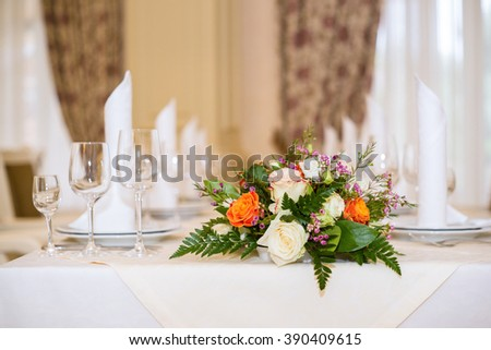Wedding floral arrangement on the table.