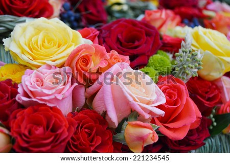 wedding floristry,bridal bouquet, roses are red, yellow roses, pink roses - stock photo