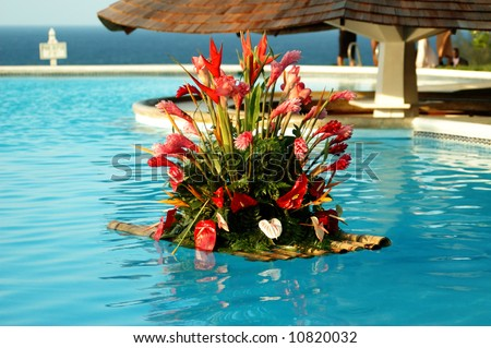 Wedding flower bouquet floating in the pool - stock photo