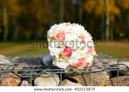 Wedding flower bouquet placed on table, forest background - stock photo