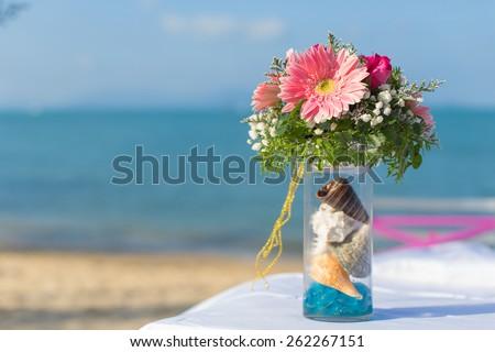 wedding flower setting on the beach - stock photo