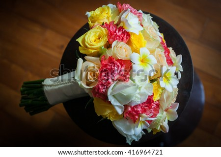 Wedding flowers bouquet of colorful roses.