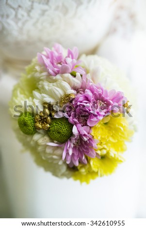 Wedding flowers. Bride is holding a bouquet of flowers. Shallow depth of field. - stock photo