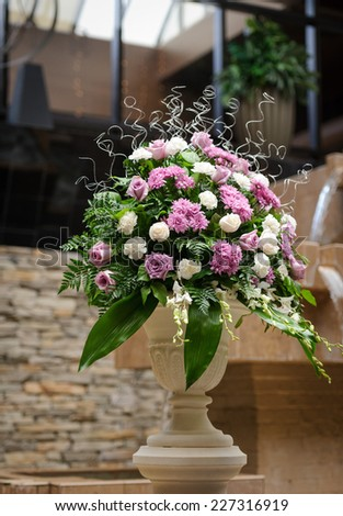 Wedding flowers church decoration - stock photo