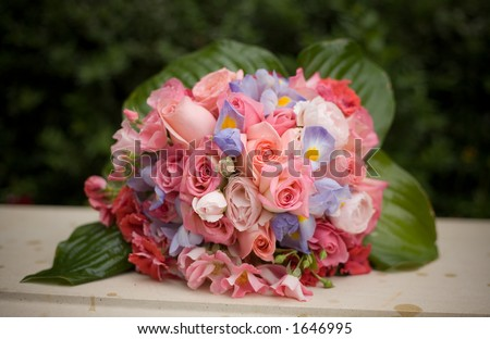 Wedding flowers from a bridal bouquet with a shallow depth of field on the front flowers - stock photo
