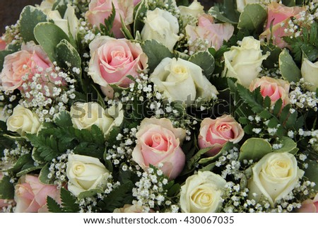 Wedding flowers in pink and white roses and gypsophila