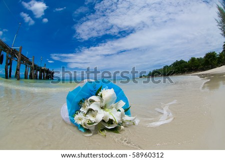 Wedding flowers on a beach