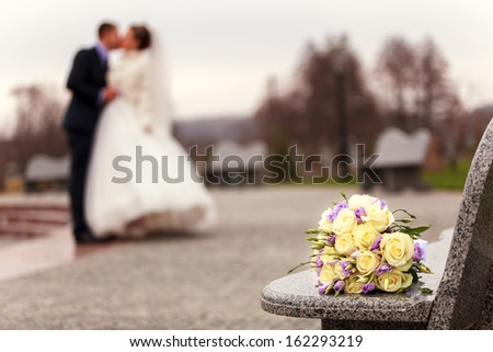 Wedding flowers on a bench - stock photo