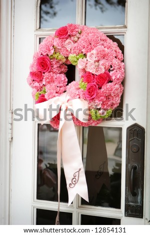 Wedding flowers on a church door - stock photo
