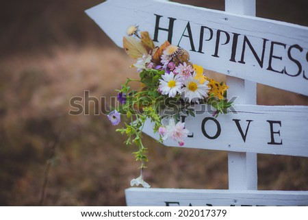 wedding flowers on arrows love happiness - stock photo