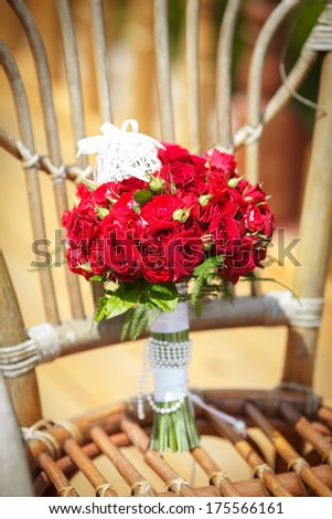 Wedding flowers red roses bouquet of Bride. Beautiful bridal bouquet. Wedding decoration