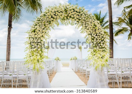 Wedding flowers setting on the beach. - stock photo