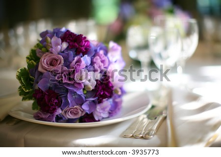 Wedding flowers - tables set for fine dining - stock photo